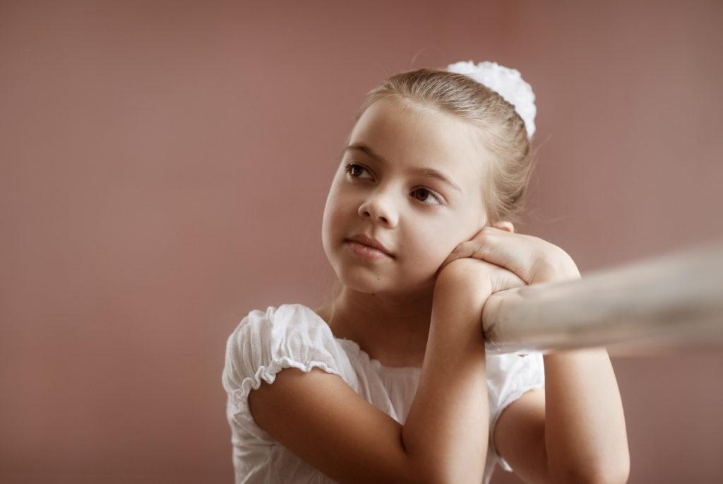 Little Girl Ballerina Holds onto Ballet Bar 108226441_1252x839